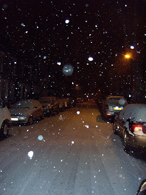 Snow falling at night in London