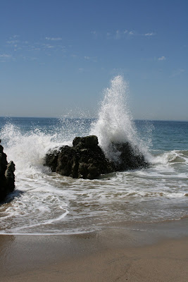 Waves crashing over rocks at Sycamore Cove