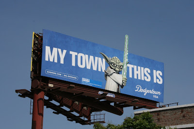 Yoda sparkling lightsaber Dodgertown billboard