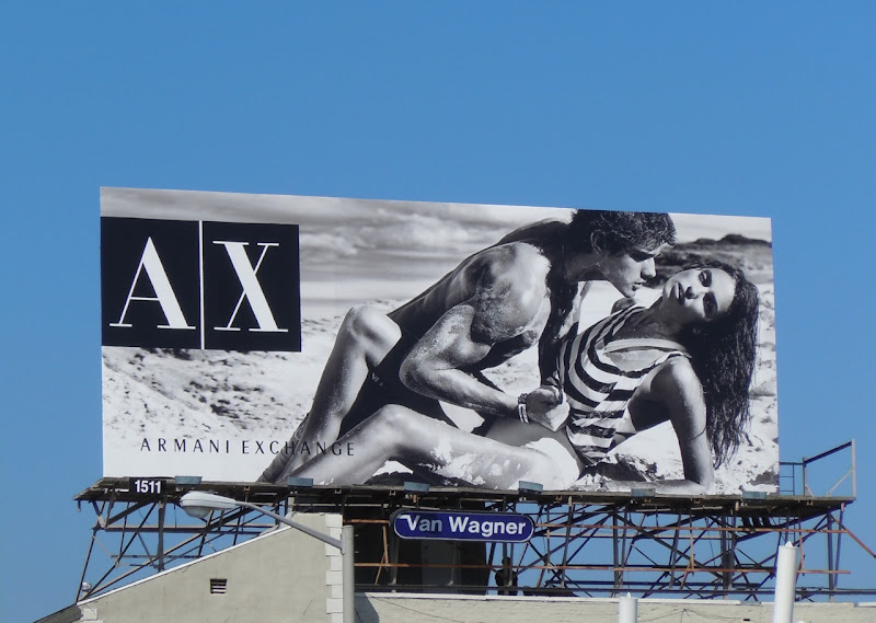 Steamy Armani Exchange beach billboard