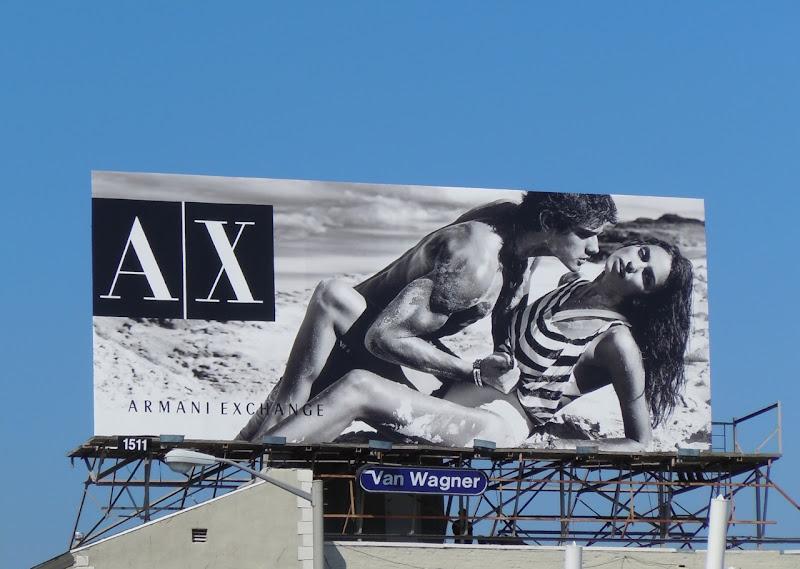 Steamy Armani Exchange beach billboard