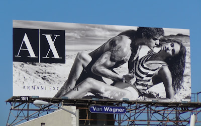 AX buff male beach model billboard