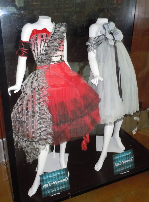 Hollywood Movie Costumes And Props Alice In Wonderland Dresses And Stayne Costume On Display ...