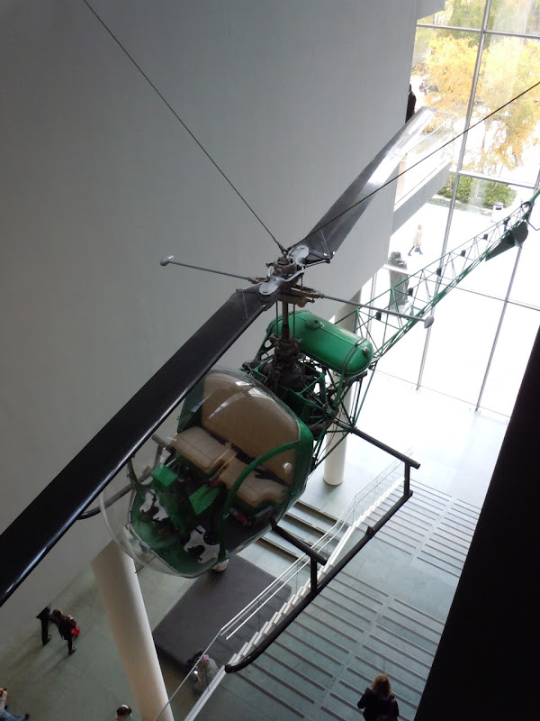 Suspended green helicopter MoMA