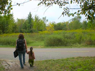 Grandma on a nature walk with preschooler.