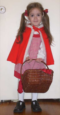 My preschooler as Little Red Riding Hood at Halloween time.