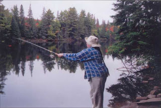 Thirty-something woman fishing in Algonquin Park.