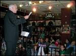 Archbishop Edwin F. O'Brien of Baltimore speaks to a mostly young Catholic audience at Pat Troy's Ireland's Own pub in Alexandria [Virginia].