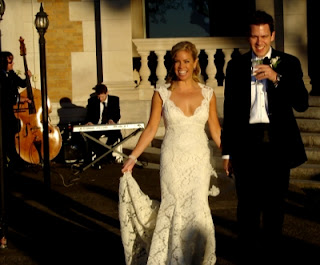 bride and groom hold hands as they walk