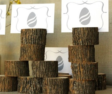 stacked pieces of tree stumps with cards with an egg image placed on top
