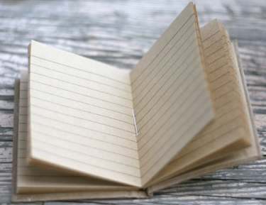 an open lined-paper notepad
