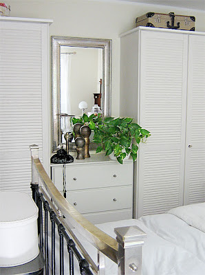 mirror above a chest with drawers