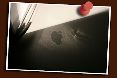 apple logo reflection on desk