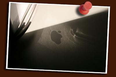 apple logo reflection on desk