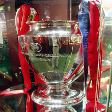 RING MAN U AND ASK IF WE CAN BUY THERE EMPTY TROPHY CABINETS