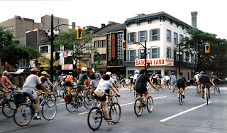 Hamilton cyclists in a mass ride turn onto King Street downtown, May 1998