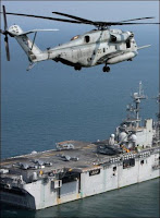A helicopter prepares to land on the USS Kearsarge anchored off Bangladesh