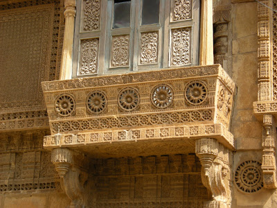 balcony designs can be highly intricate with both relief carvings