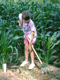 girl with rake in garden Third Plane of Development Ages 12-18 NAMC Montessori Philosophy