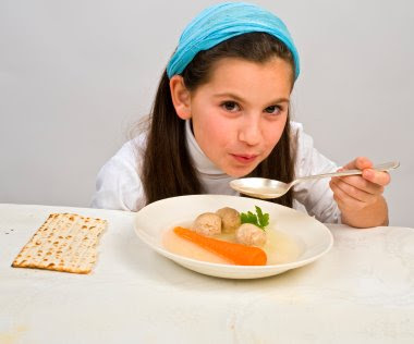 NAMC montessori classroom activities cultural curriculum Jewish passover girl eating soup