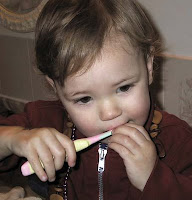 NAMC montessori education work and play girl brushing teeth