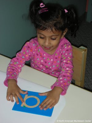 NAMC montessori education nurturing concentration in child respect observation modeling behavior using sandpaper
