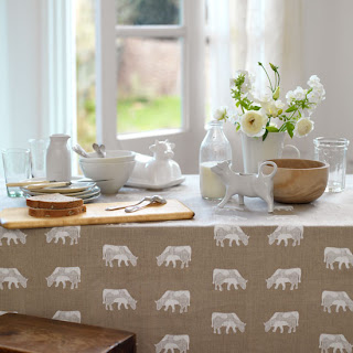 Country Kitchen Table Choose a natural linen with a simple cow print for your breakfast table, teaming it with hand thrown ceramics and a porcelain cow creamer