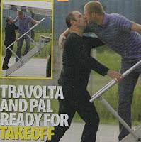 travoltakiss John Travolta Continues Straight Campaign