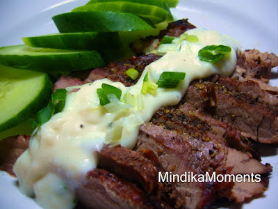 PEPPERED FLANK STEAK WITH BLUE CHEESE SAUCE