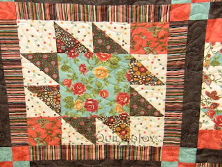 Sophisticated Quilt with Funky Fleur de Lis pantograph, quilted by Angela Huffman