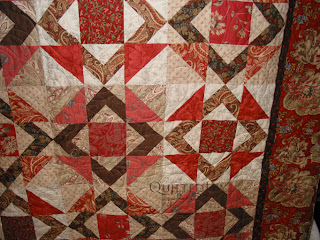 Square in a Square in reds with the Featheration Pantograph. Quilting by Angela Huffman - QuiltedJoy.com