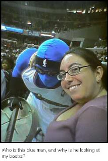Who is this blue man? The Wizards mascot?