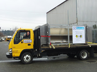 The Hydrovolts Flipwing Turbine arrives at McKinstry on a flatbed truck