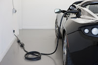 Tesla Roadster plugged in and charging