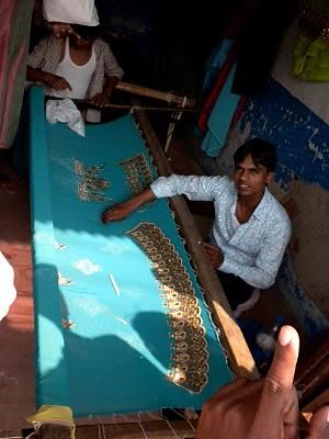 Man Beading a Sari