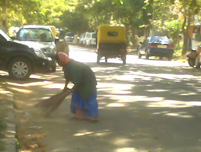 Woman Sweeping Street in India