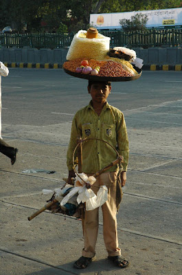 Man Carrying Load on His Head in India