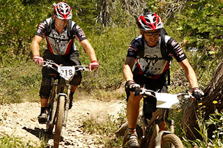 Photograph of Bobby McMullen and guide biking (courtesy of Poison Oak Productions)