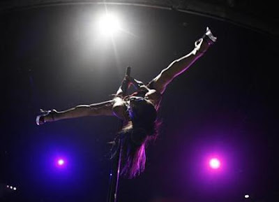 A pole dancer performs during Chopper Night 2008 in Tokyo July 27, 2008. REUTERS/Toru Hanai