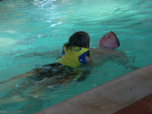 Parker and Daddy swimming at the lodge