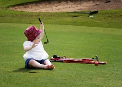 Fort Worth baby photography of professional golfer's baby on golf course with golf clubs