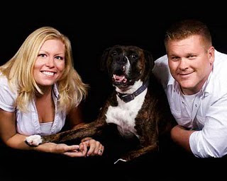 Keller family photo of couple with boxer dog