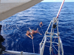 Swimming behind the boat on the crossing