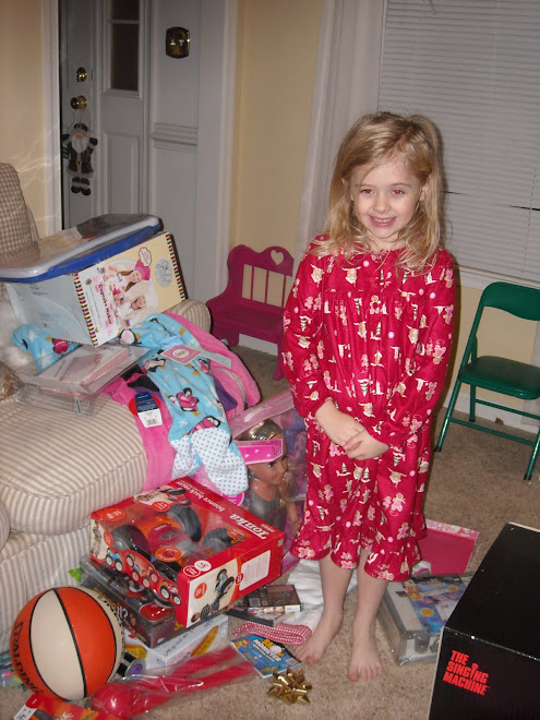 Taylor and her many presents!!!!
