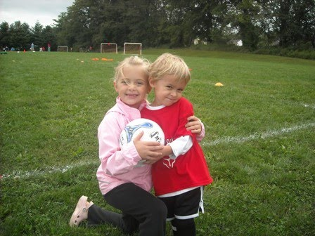 Taylor cheering Luke on at soccer practice!!!!