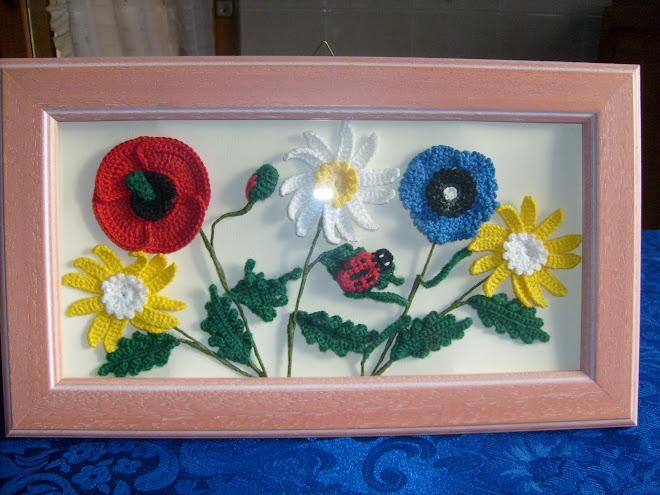 quadro con fiori di campagna e coccinella