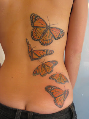 five monarch butterflies at lower back tattoo Five Monarch Butterflies