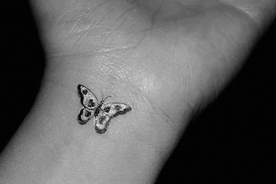 Little butterfly tattoo in the left arm [Image Credit: jefbr ]