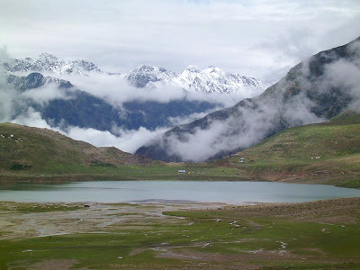Full view of Lake Saiful Muluk and the surrounding mountains