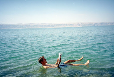 Tourist floating in the Dead Sea